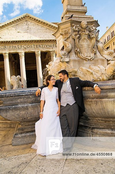 Bride and groom at Pantheon fountain in Rome  Italy
