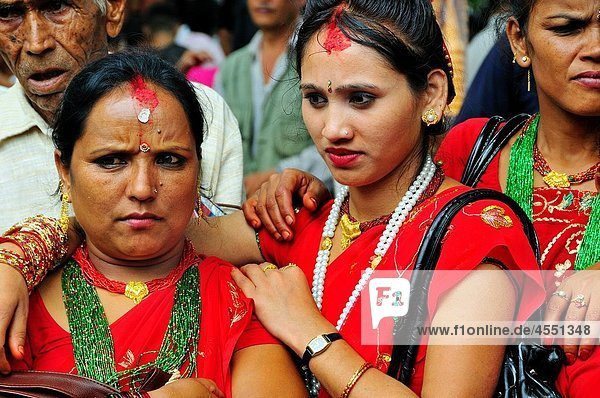 Mother and daughter on the day of Teej festival at Pachali Bhairab Temple  Kathmandu Nepal