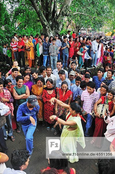 On the day of Teej festival at Pachali Bhairab Temple There were many groupes of people were dancing traditional dance  Kathmandu Nepal