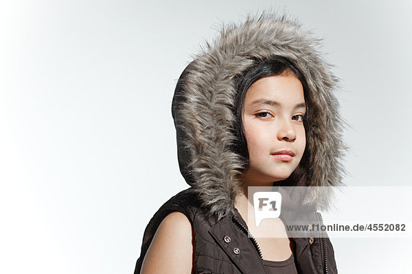 Girl wearing fur hood