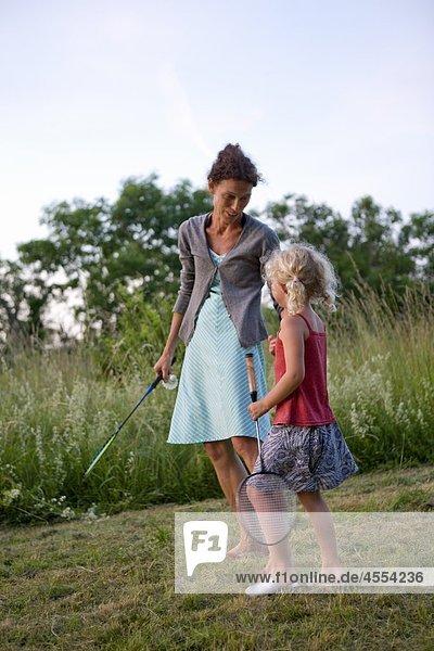 Garten Tochter Mutter - Mensch Badminton spielen