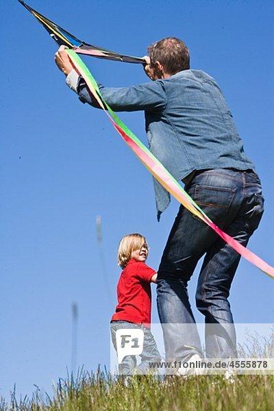 fliegen fliegt fliegend Flug Flüge Menschlicher Vater Sohn