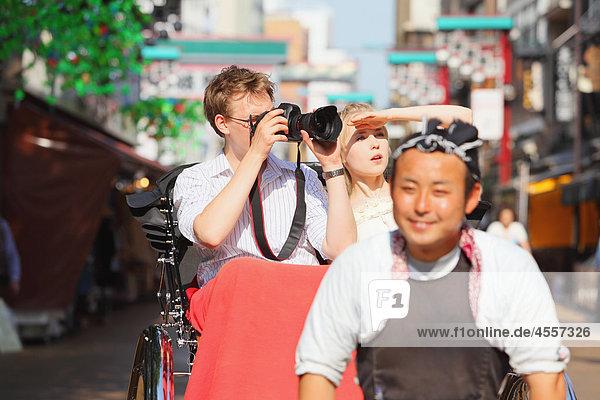Young Couple Sitting In Rickshaw In Asakusa  Japan