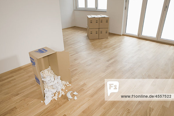 Stack of cardboard boxes in empty apartment  Munich  Bavaria  Germany
