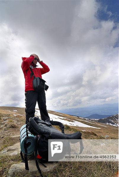 hiker on Chornogora Ridge of Carpathian Mountains