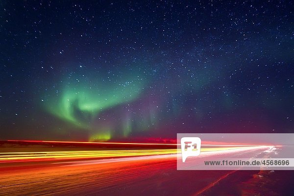 Aurora Borealis Northern Polar Lights with truckers lights on the ice road outside Yellowknife  Northwest Territories  Canada  MORE INFO The term aurora borealis was coined by Pierre Gassendi in 1621 from the Roman goddess of dawn  Aurora  and the Greek n