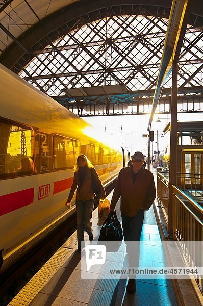 Passengers arrive at the train station at Dresden after sunrise  Saxony  Germany