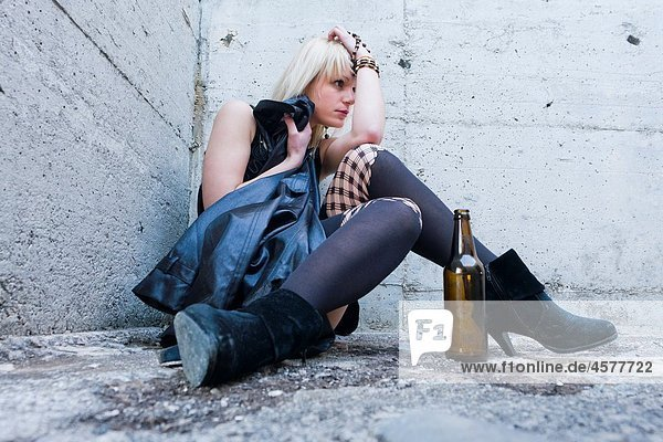 Drunk and exhausted young woman