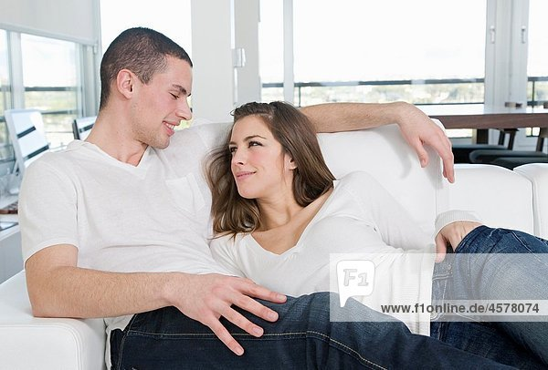 Portrait of a couple at home relaxing in the sofa