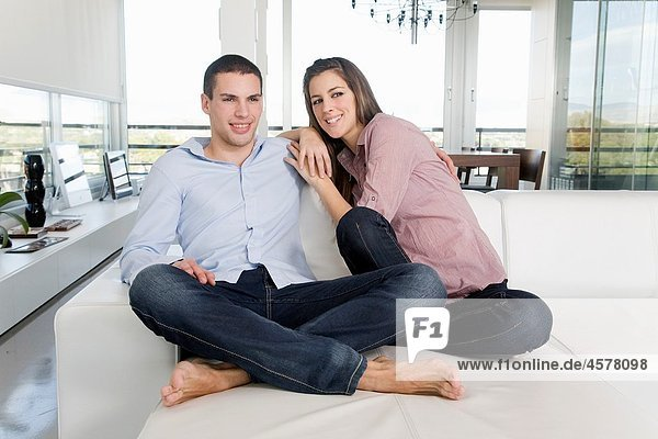 Portrait of a young couple in sofa