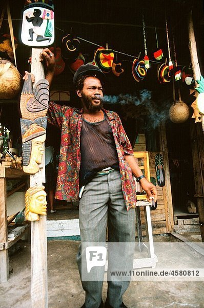 Jamaican man smoking a joint in front of a shop in Negril  Jamaica