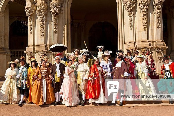 A procession of the Royal Court of August the Strong people in historical costume at the Dresden Zwinger  Dresden  Saxony  Germany