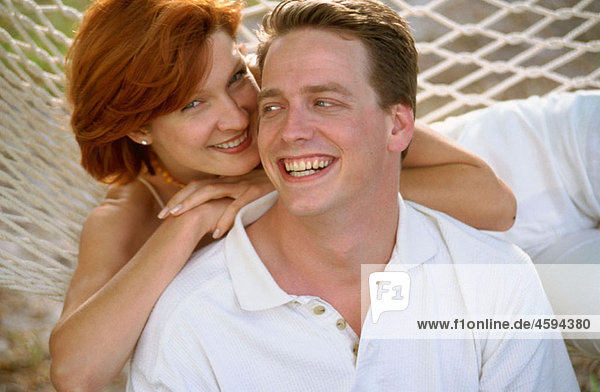 smiling couple on a hammock