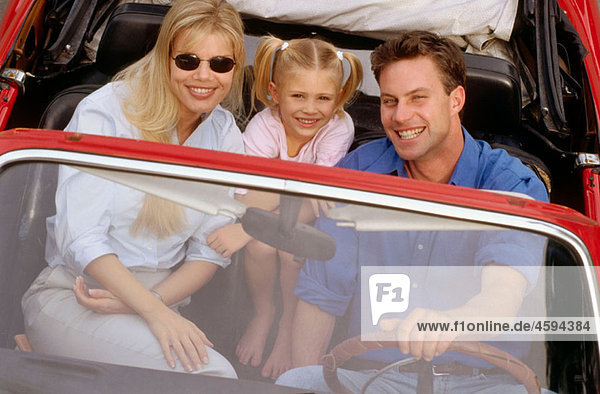 family in a convertible sport car