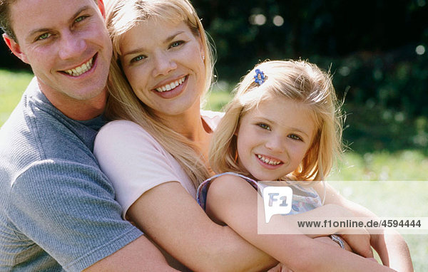 smiling/embracing family