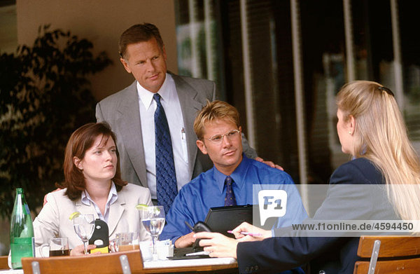 four at a business lunch