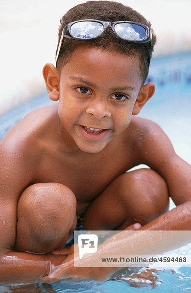 kid in a swiming pool