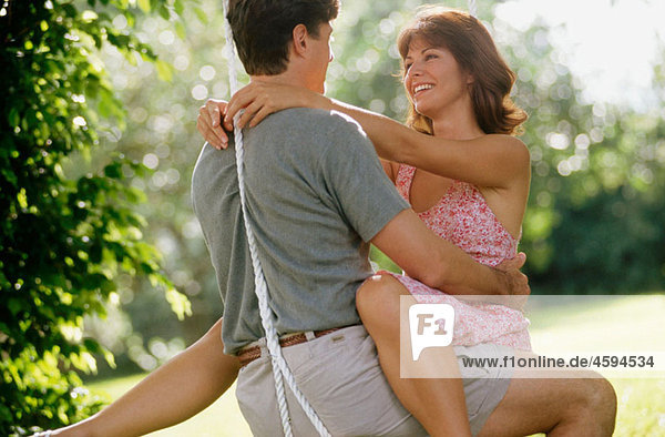 couple in love on a swing