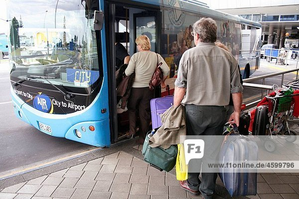 Passengers getting into airport shuttle bus  Auckland International Airport  Manukau Bay  North Island  New Zealand