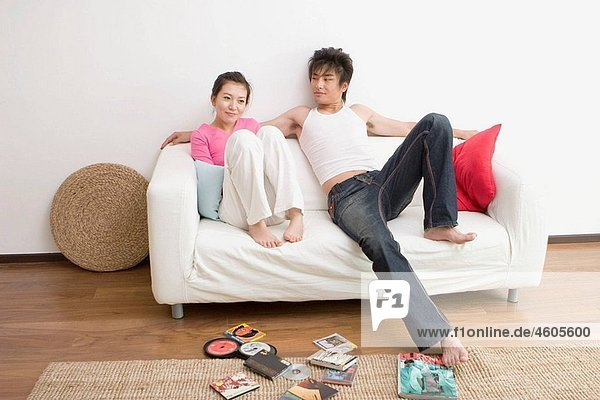 Young Couple watching movie on tv.