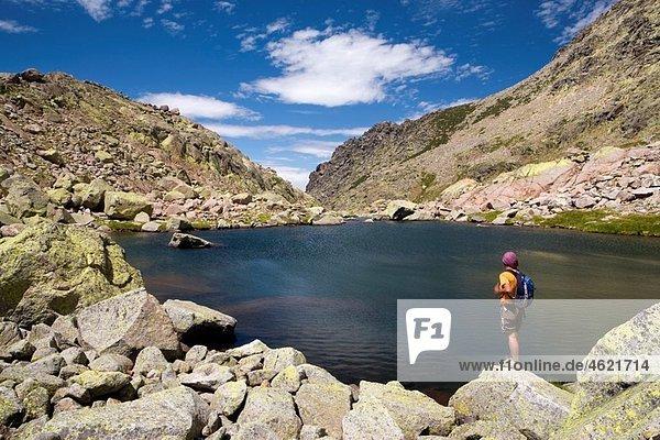 Cinco Lagunas Valley Garganta del Pinar Woman practice mountaineering in the mountains of the Sierra de Gredos National Park Zapardiel de la Ribera ¡vila Castilla y LeÛn Spain