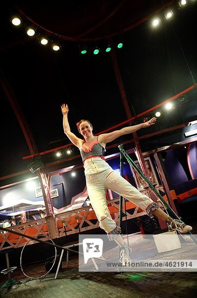 A young woman balancing on the slack wire  No Fit State Circus  performing  Wales UK