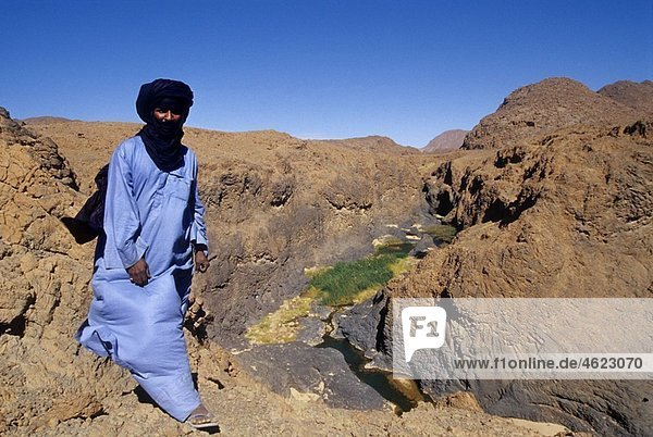 man on the edge of a canyon around Timia  village of AÃ r Niger Western Africa