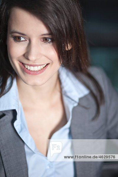 Business woman looking away  smiling