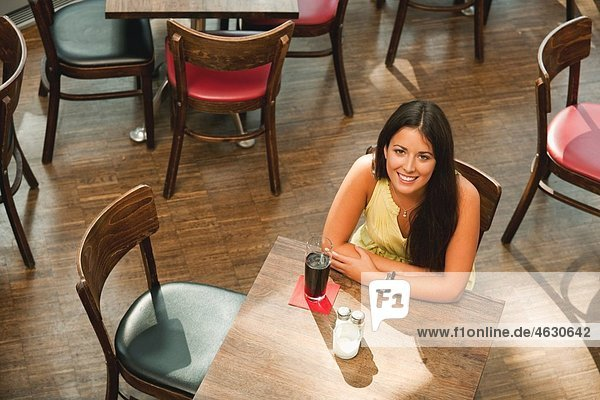 Young woman in cafe  smiling  portrait
