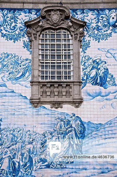 Azulejos typical earthenware tiles on an outside wall of do Carmo churh 18th c Porto Portugal Azulejos typical earthenware tiles on an outside wall of do Carmo churh 18th c Porto Portugal