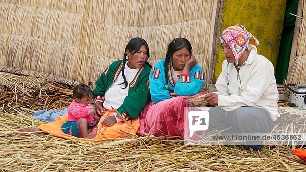Uros Indians who live on the man-made floating islands  Uros floating islands offshore from Puno  Lake Titicaca  Peru