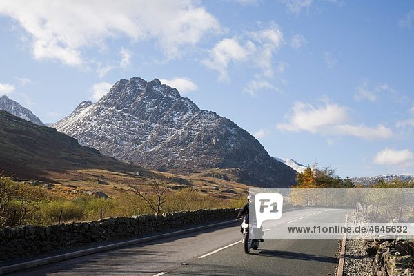 Ogwen  Conwy  North Wales  UK  Europe View along historic A5 road through Ogwen Valley to Tryfan mountain east face in Snowdonia National Park