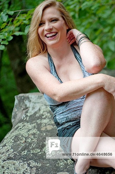 Thirty eight year old blond woman in casual clothes in outdoor setting