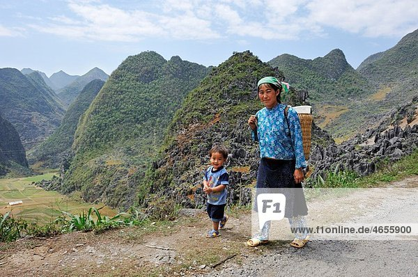 HÂ¥mong women and child at the roadside around Dong Van  Ha Giang province  northern Vietnam  southeast asia