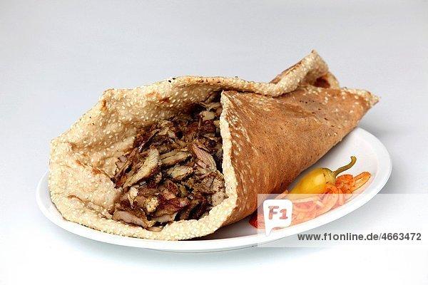 Lamb and turkey shawarma in a Lafa flat Iraqi pita