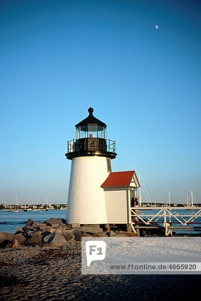Brant Point Lighthouse at entrance to Nantucket Harbor on Nantucket Island  Massachusetts  USA Young woman tourist in doorway
