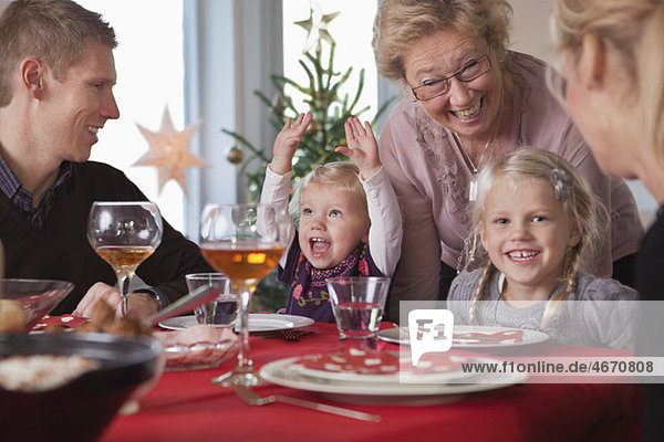 Glass Dinner Table on Happy Family At The Dinner Table   Buy Premium Quality Stock Photos
