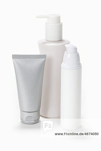 Cosmetic bottles and a tube