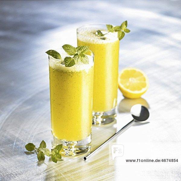 Orange drinks with honey  soda and mint