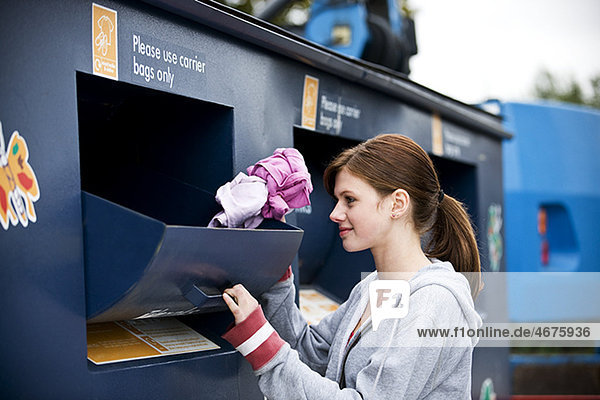 A teenage girl recycling clothes LV14110049