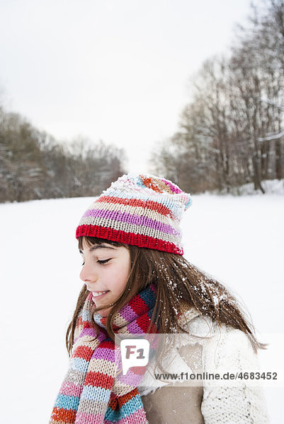 Girl standing in snowfield