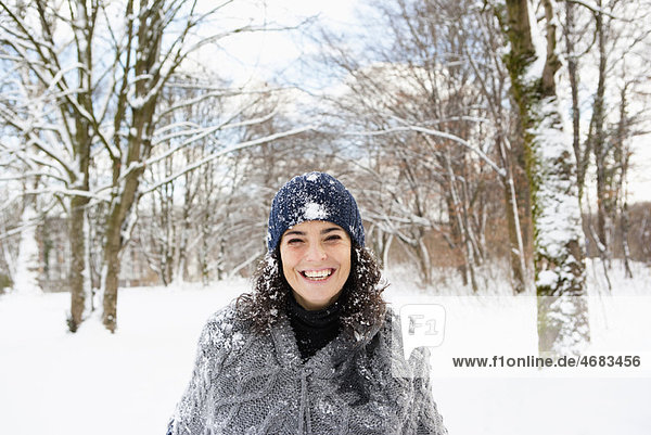 Woman taking a walk in snowy woods
