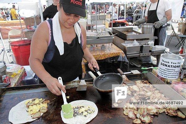 Florida  St Petersburg  Progress Energy Park  Farmers Market  Hispanic  woman  cook  cooking  food  for sale