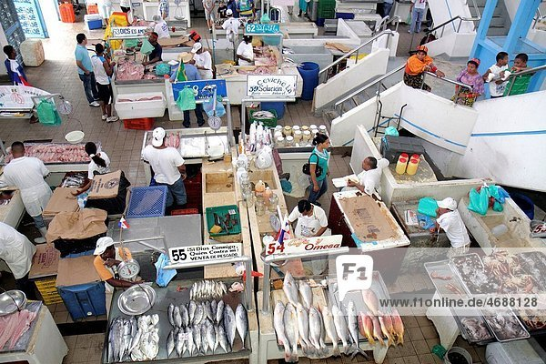 Panama  Panama City  Ancon  Mercado de Mariscos  market  merchant  shopping  retail  selling  fish  seafood  business  customer  Hispanic  Black  man  woman  stall  local food  view from overhead  for sale