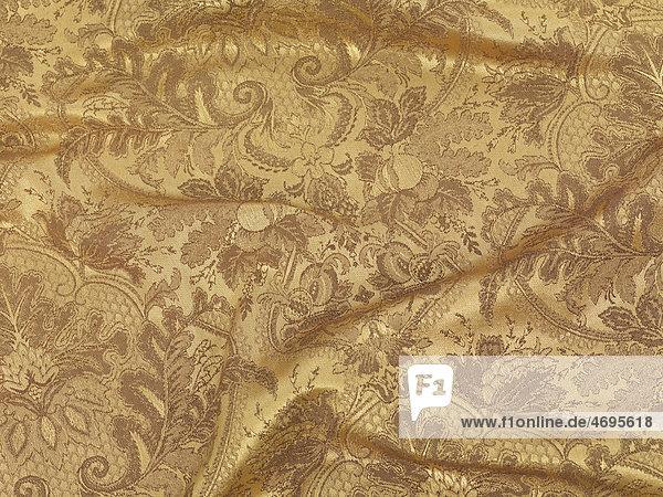 Glänzender goldener Stoff  Textur  Hintergrund