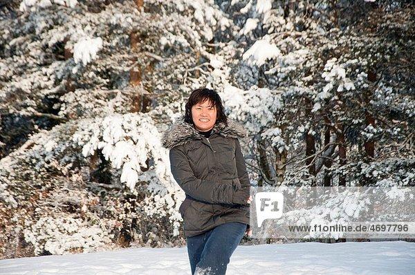 A South Korean woman has fun in the snow