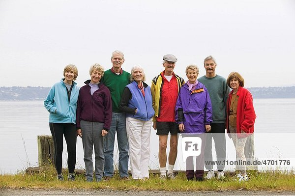 Eight middle_aged men and women in a row