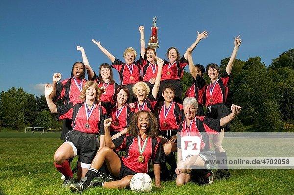 Female soccer team celebrating