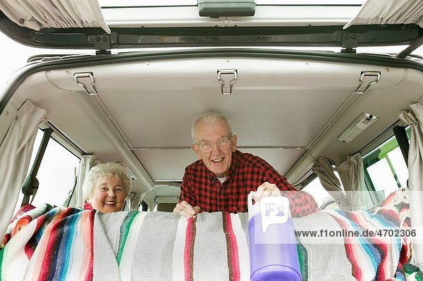 Senior couple in the back of their van