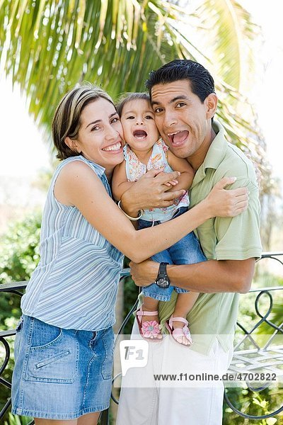 Playful parents with little girl